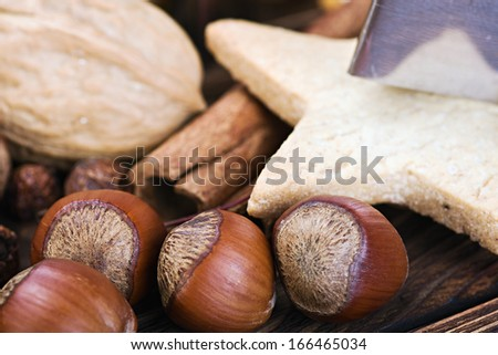 cooking and baking Christmas cookies.  Shallow depth of field, focus on front nuts - stock photo