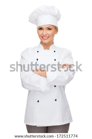 cooking and food concept - smiling female chef, cook or baker with crossed arms - stock photo