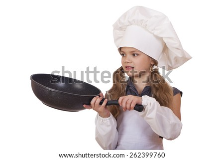 cooking and people concept - smiling little girl in cook hat with frying pan - stock photo