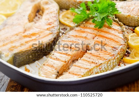 Cooking at home fresh salmon with lemon parsley - stock photo
