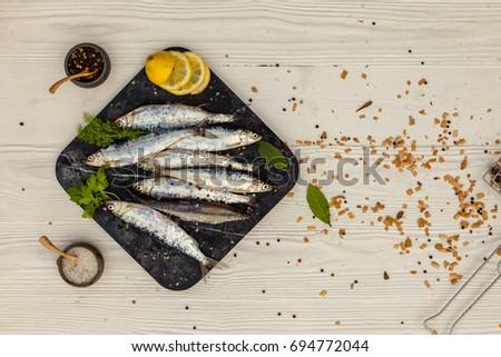 White fish lemon arugula on white stock photo 244426456 for Cooking white fish