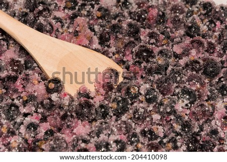 cooking black currants in the rural kitchen - stock photo