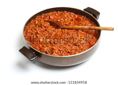 Cooking bolognese sauce in wide saucepan - stock photo