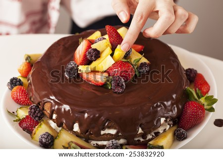 cooking cake: final decoration - stock photo