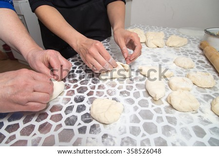 cooking cakes of the dough in the kitchen
