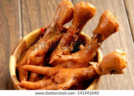 Cooking chicken feet - stock photo
