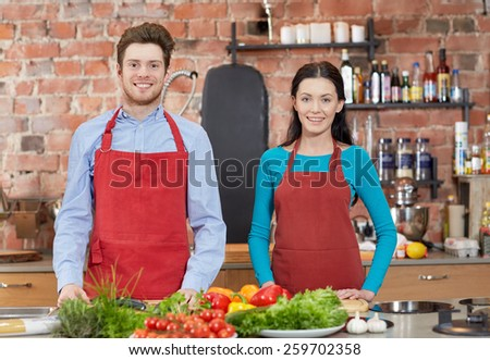 cooking class, culinary, food and people concept - happy couple in kitchen - stock photo