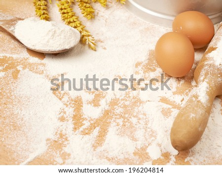 Cooking composition of a flour, wheats and eggs over the wooden surface - stock photo