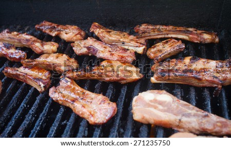 Cooking delicious pork ribs on the grill - stock photo