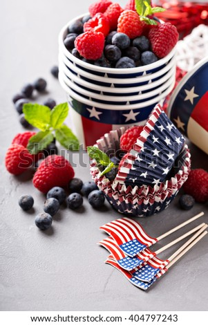 Cooking desserts with berries for Independence Day paper cups and flags