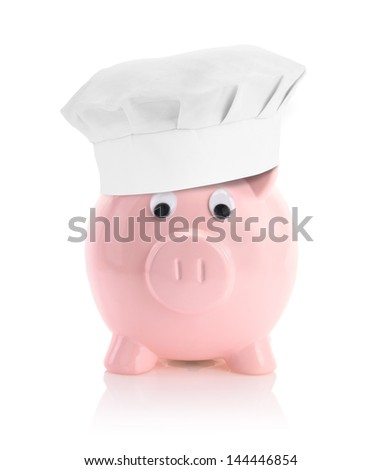 Cooking economy represented by a piggy bank with a chef hat - stock photo