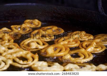 Cooking famous Indian sweet jalebi  - stock photo