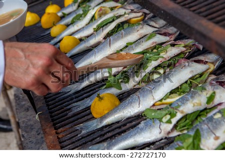 cooking fish for dinner on grill - stock photo