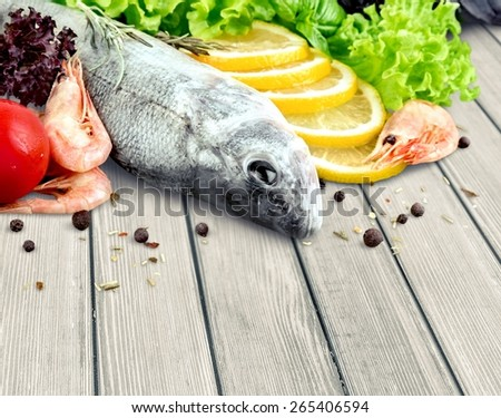 Cooking. Fresh seafood and vegetables over white (with easy removable sample text) - stock photo