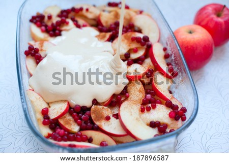 Cooking fruit and berry pie - apple, cranberry and foxberry, russian cuisine. Raw food on table background. Organic ingredients, healthy food.