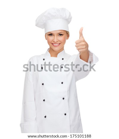 cooking, gesture and food concept - smiling female chef, cook or baker showing thumbs up - stock photo