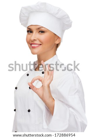 cooking, gesture and food concept - smiling female chef showing ok hand sign - stock photo