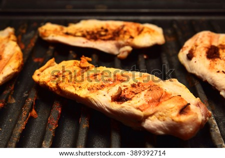 cooking Grilled chicken breast on the grill - stock photo