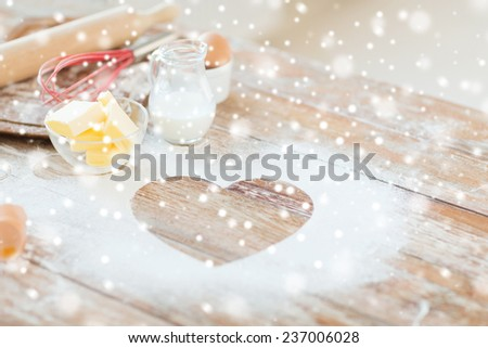 cooking, holidays, home and love concept - close up of heart of flour on wooden table - stock photo