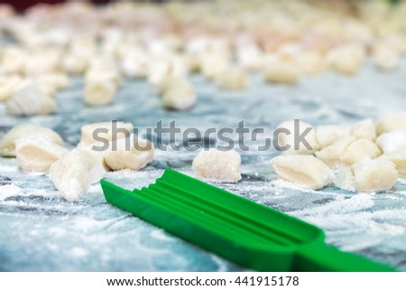Cooking homemade gnocchi for lunch. - stock photo