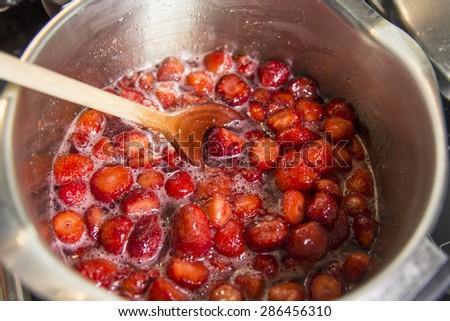 cooking homemade jam  - stock photo