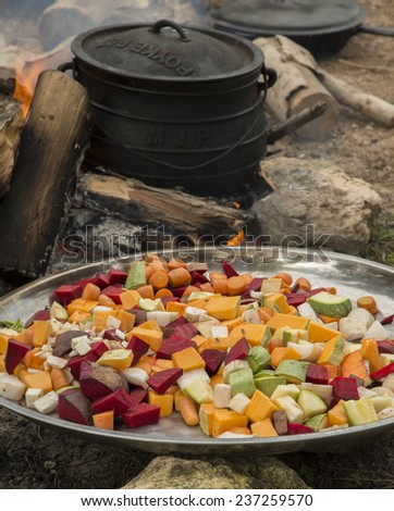cooking in cauldron on burning campfire  - stock photo