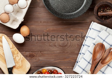 Cooking ingredients and utensils on wooden table. Top view with copy space - stock photo