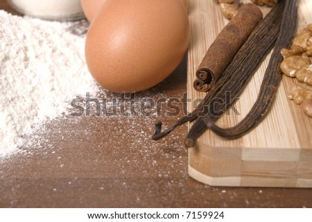 cooking ingredients. flour, eggs, sugar, spices - cinnamon, vanilla and nuts