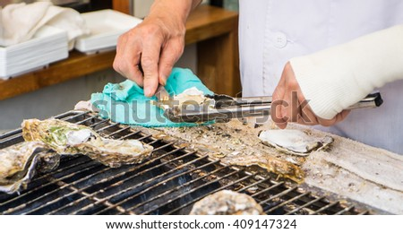 Cooking Japanese Oysters - stock photo