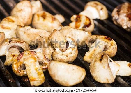 Cooking mushrooms on the grill in the restaurant