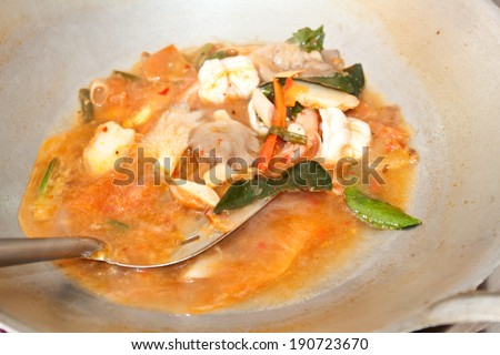 Cooking of Tom Yum soup (Tom Yum Goong)