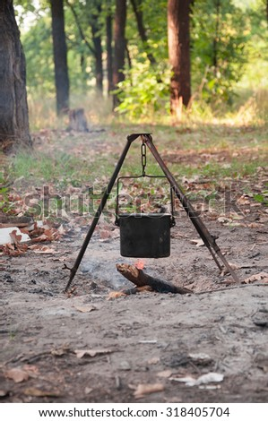 cooking on a fire in the boiler outdoors - stock photo