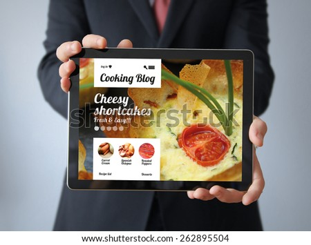 cooking online concept: businessman with cooking blog - stock photo