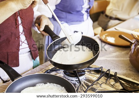 Cooking pancakes on a fair, detail of a position in a market, healthy food, party - stock photo
