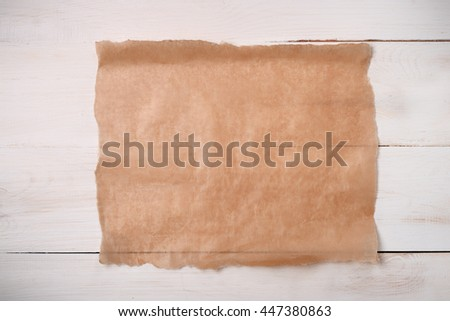 Cooking paper sheet on wooden board