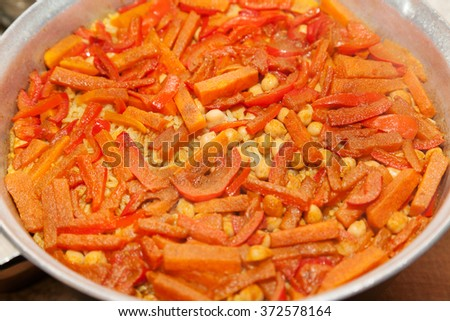 Cooking pot with rice and sweet pepper - stock photo