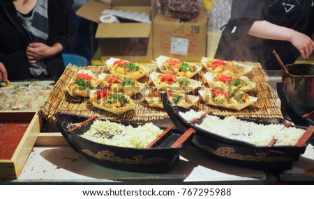cooking process of the most famous Takoyaki of Osaka,Japan. Buying Takoyaki