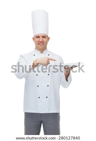 cooking, profession, advertisement and people concept - happy male chef cook showing something on empty plate - stock photo