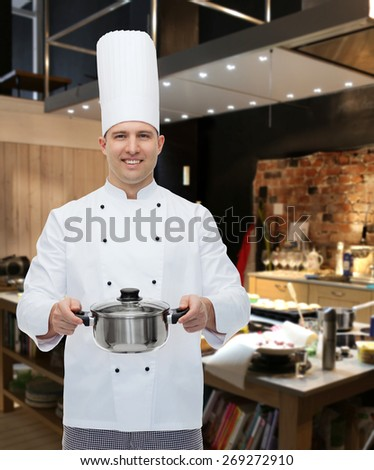 cooking, profession and people concept - happy male chef cook holding pot over restaurant kitchen - stock photo