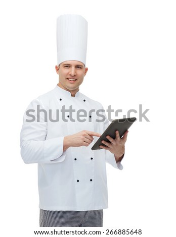 cooking, profession and people concept - happy male chef cook holding tablet pc computer - stock photo