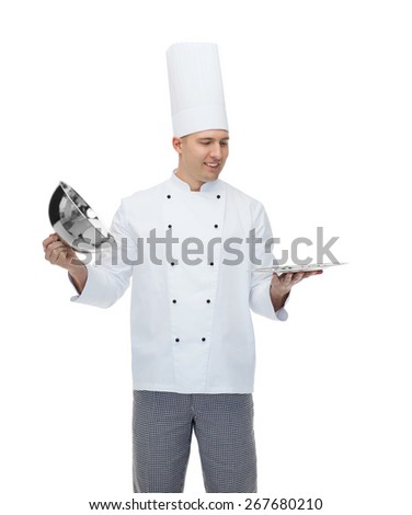 cooking, profession and people concept - happy male chef cook opening cloche cover - stock photo