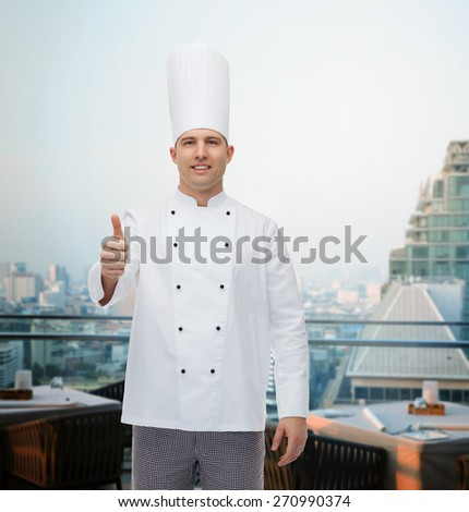 cooking, profession, gesture and people concept - happy male chef cook showing thumbs up over city restaurant lounge background - stock photo