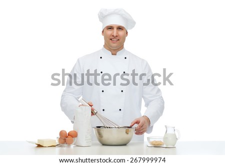 cooking, profession, haute cuisine, food and people concept - happy male chef cook baking - stock photo