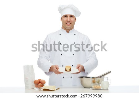 cooking, profession, haute cuisine, food and people concept - happy male chef cook baking dessert - stock photo