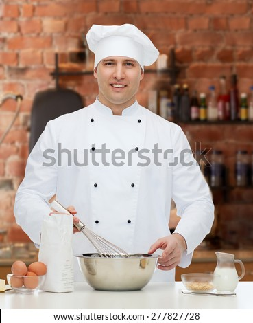 cooking, profession, haute cuisine, food and people concept - happy male chef cook baking over kitchen background - stock photo