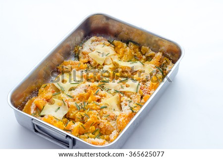 Cooking pumpkin baked with cheese