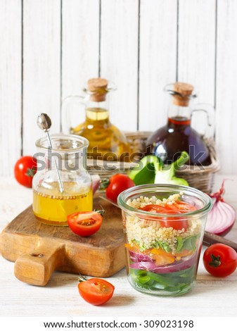 Cooking quinoa vegetables salad on white wooden table. - stock photo