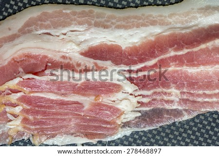 Cooking raw bacon on skillet