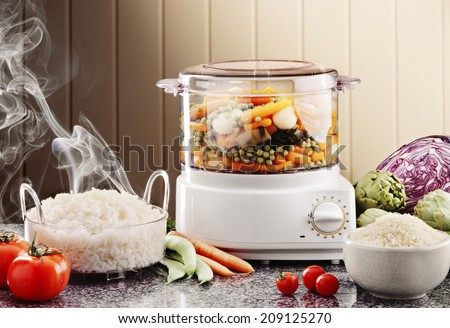 cooking rice and veggies with an electric cooker - stock photo