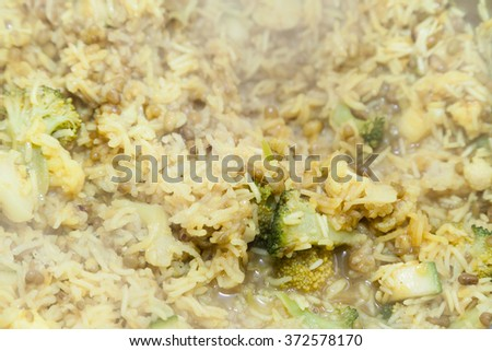 Cooking rice with broccoli and selective focus - stock photo